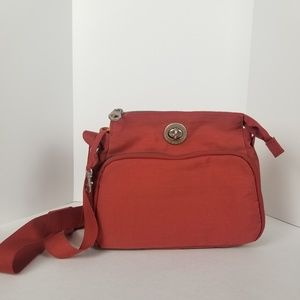 Baggallini small red purse with orange lining